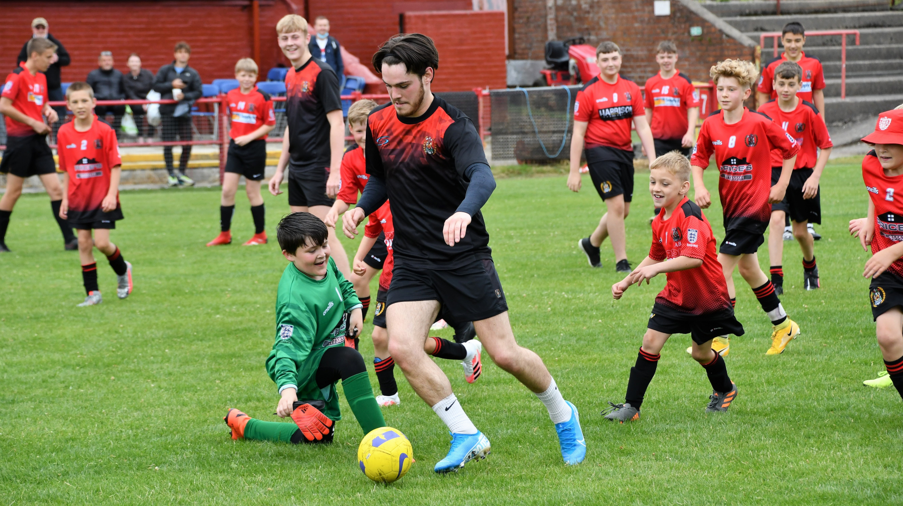 Reds Festival of Football – Robbie Hebson tries to escape the juniors