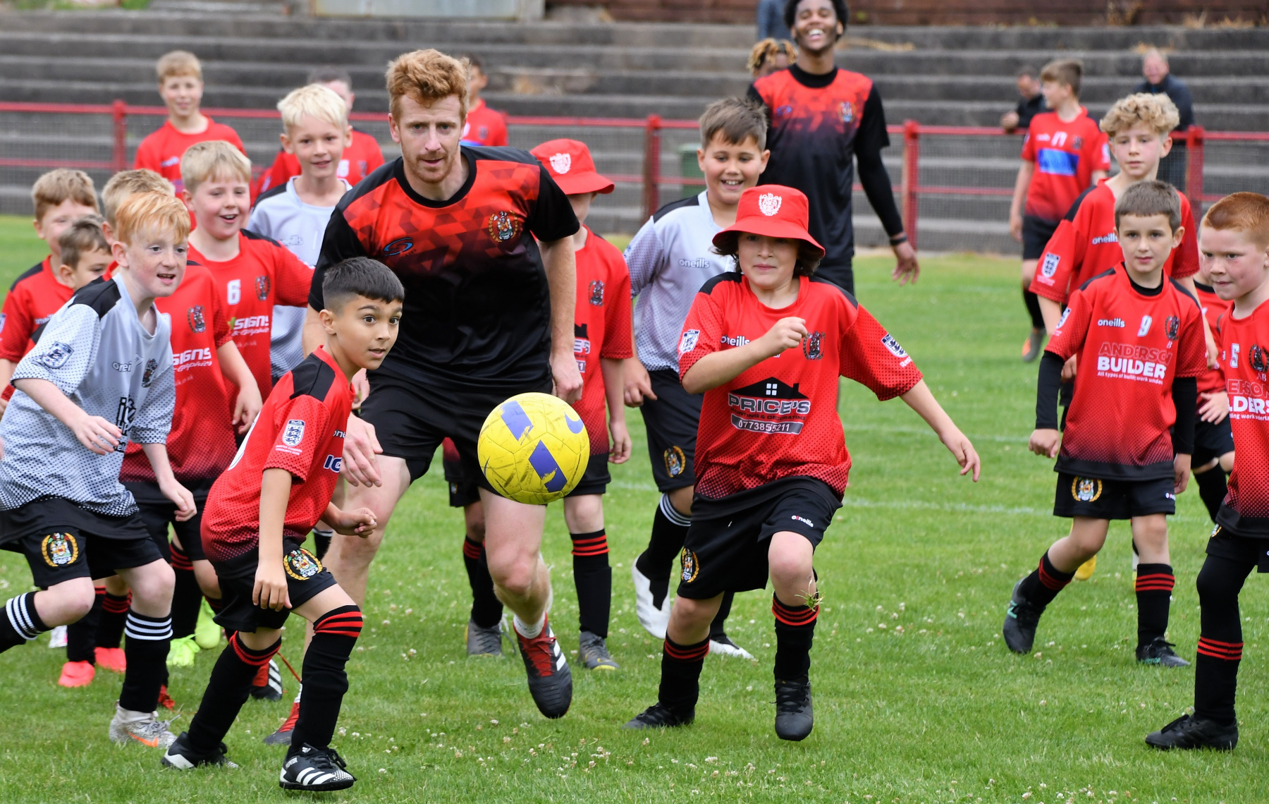 Reds Festival of Football – Scott Allison tries to find a way past the Reds juniors