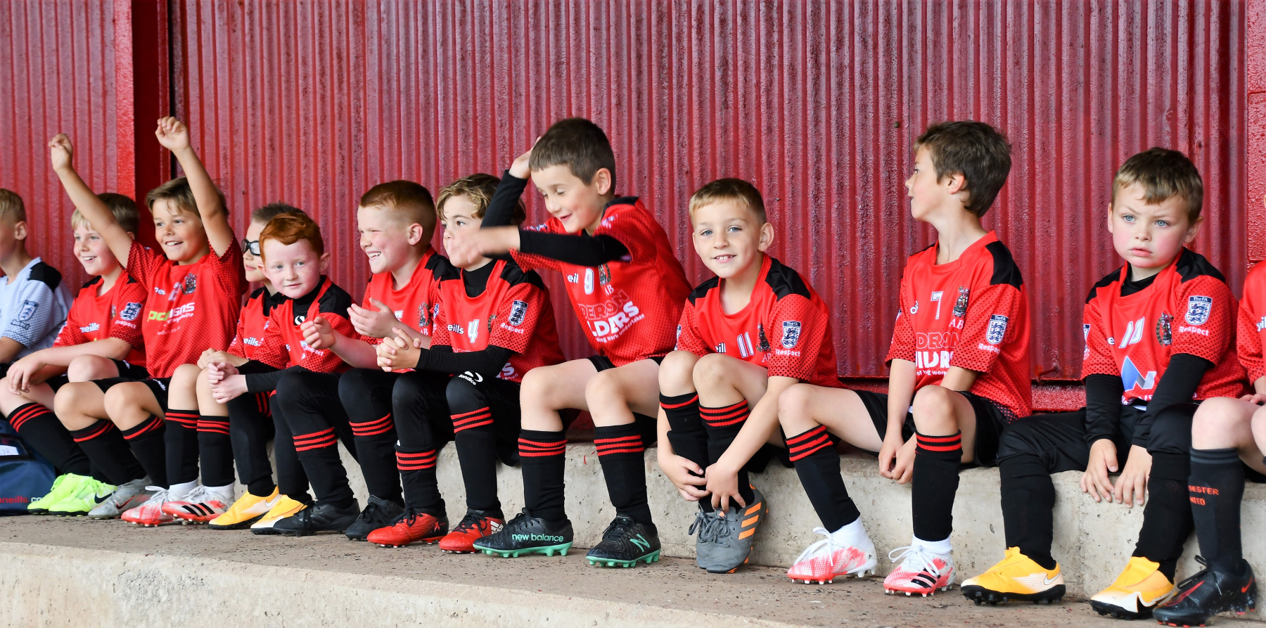 Reds Festival of Football – the Juniors learn the Mexican wave