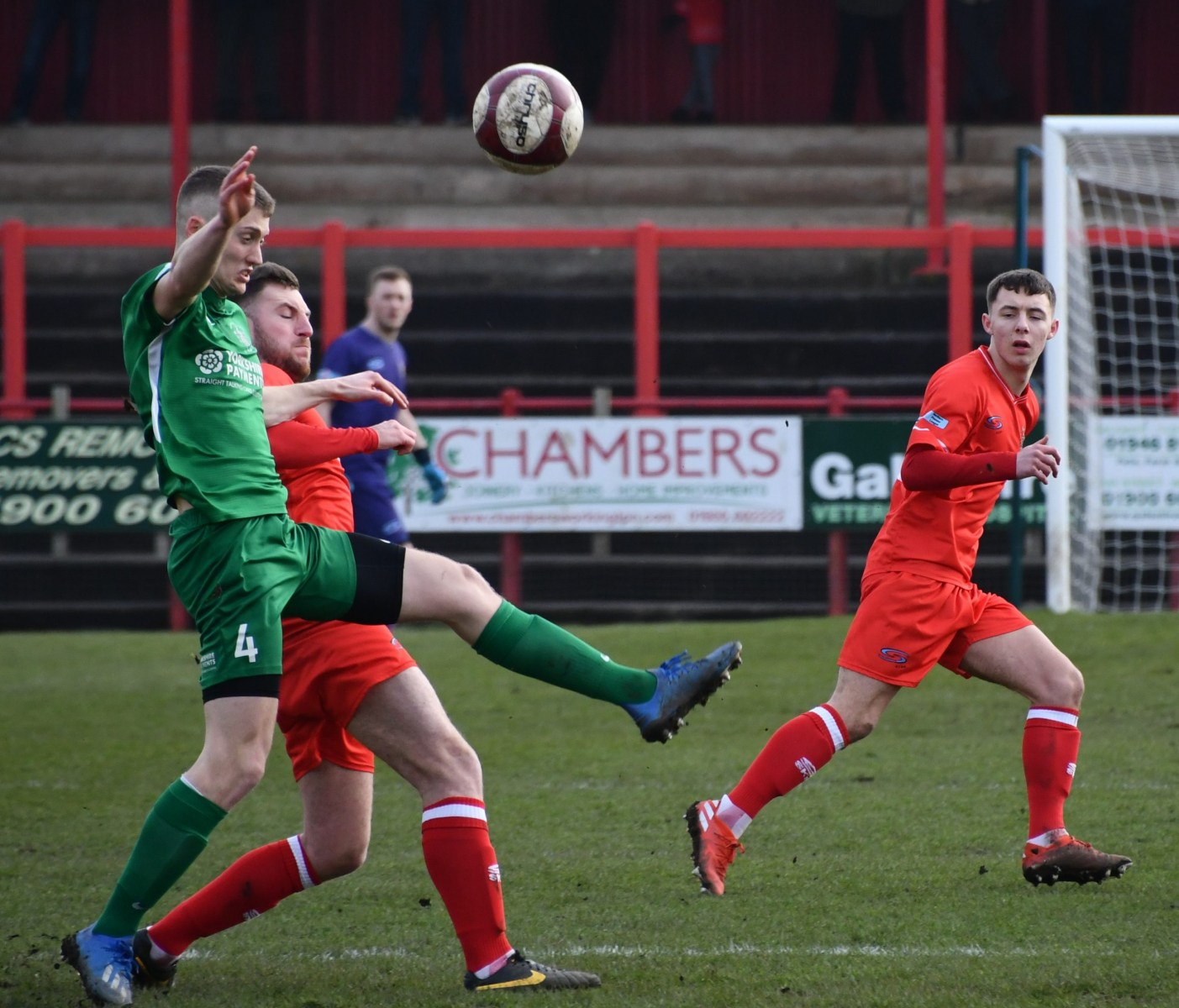Brighouses-Connor-Wright-battles-with-Brad-Carroll-for-the-ball-ben-Challis-scaled