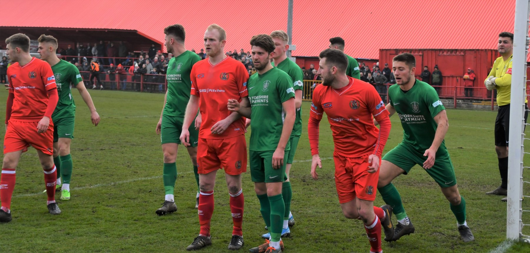 The-Reds-line-up-in-the-Brighouse-goal-mouth-Ben-Challis-scaled