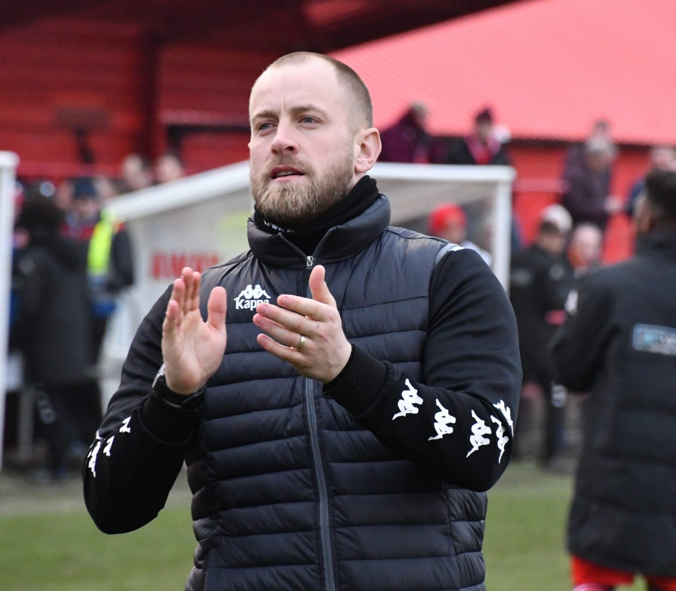 Workington-Reds-manager-Danny-Grainger-applauds-the-home-support-ben-Challis-scaled