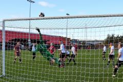 REDS-V-MOSSLEY-Matchday-Photos-Press-Ben-Challis_Liam-Lovell-tips-Jordan-Holts-shot-over-the-Mossley-bar-ben-Challis1602434707814