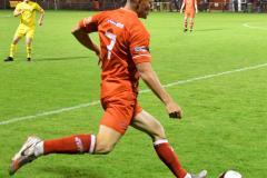 Jordan-Holt-moves-the-ball-forwards-Ben-Challis-scaled