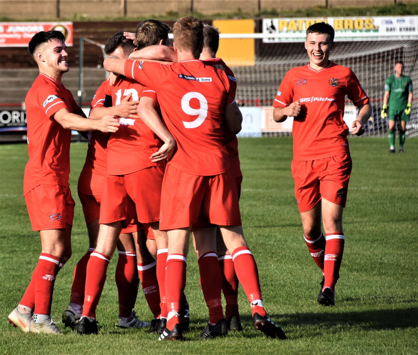 The-Reds-mob-Conor-Tinnion-after-his-corner-led-to-a-goal-Ben-Challis