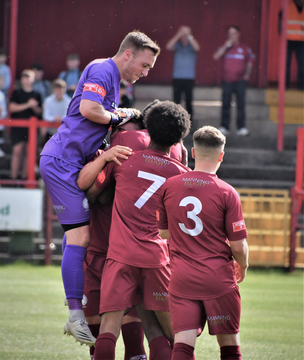The-Reds-celebrate-Dav-Symingtons-goal-Ben-Challis