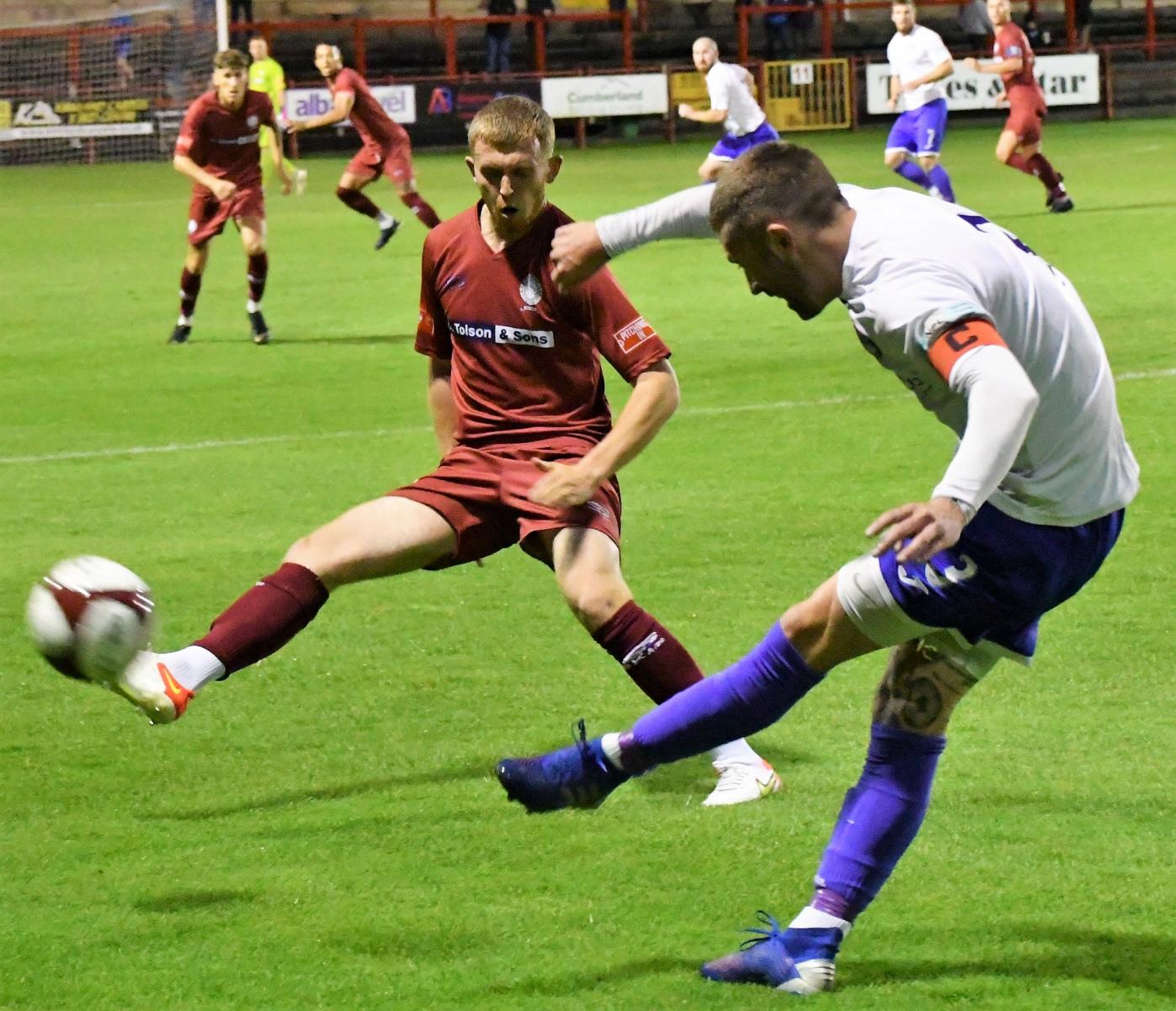 Tom-Kennedy-puts-the-ball-past-Reds-goal-scorer-Rowan-Roache-Ben-Challis
